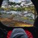 photo dans une tente ouverte sac de couchage paysage avec arbres