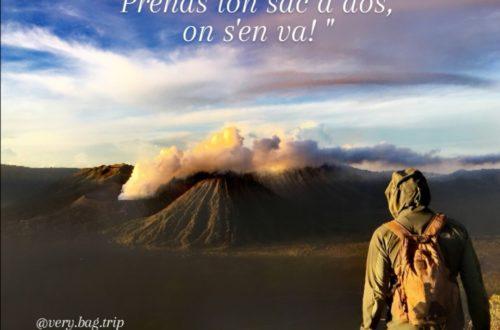 Image volcan fumant au loin homme regarde